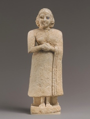 Standing female figure with clasped hands, Early Dynastic IIIA, ca. 2600–2500 BCE Mesopotamia, Nippur, Inanna temple, Level VIIB Limestone, shell, and lapis lazuli, image taken from Metropolitan Museum of Art, http://www.metmuseum.org/toah/hd/edys/hd_edys.htm
